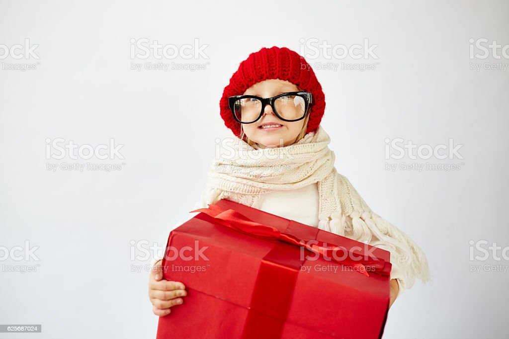 Funny little girl with Christmas present stock photo
