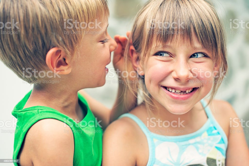 Funny little secrets royalty-free stock photo