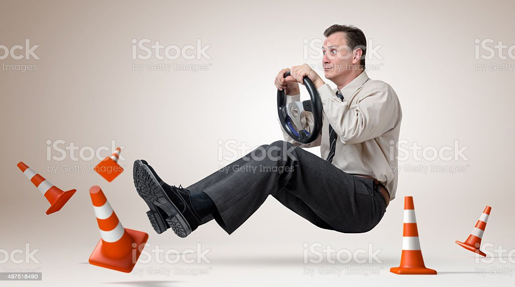 Funny man car driver with a wheel stock photo
