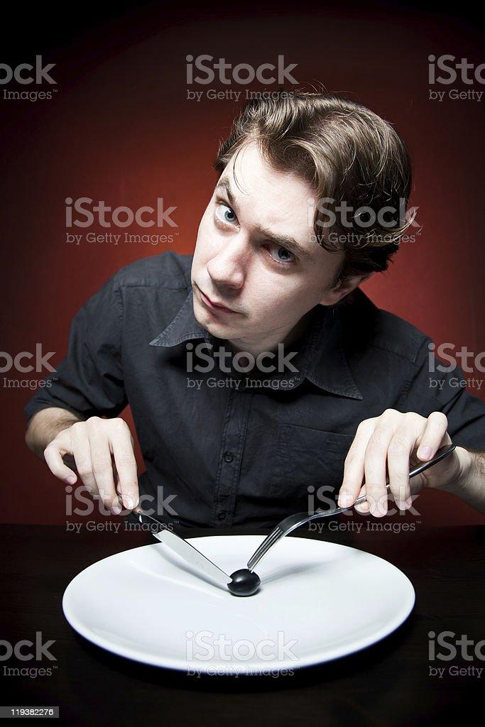 Funny man eating grape stock photo