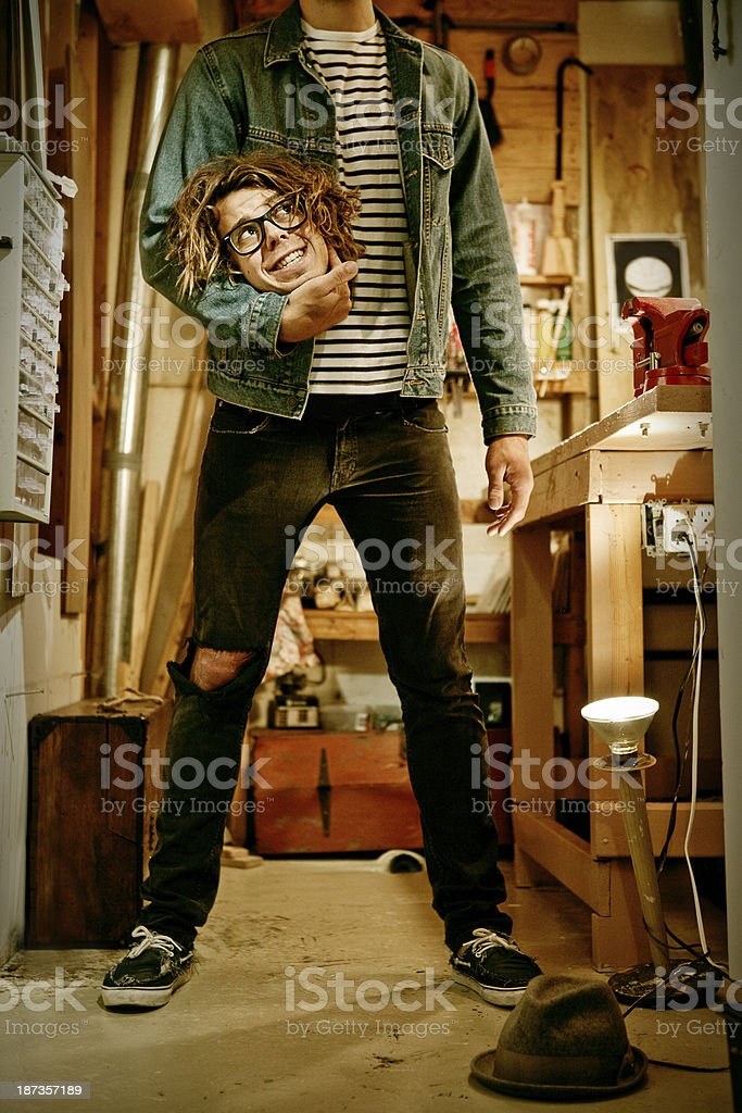 Funny man holding his own head stock photo
