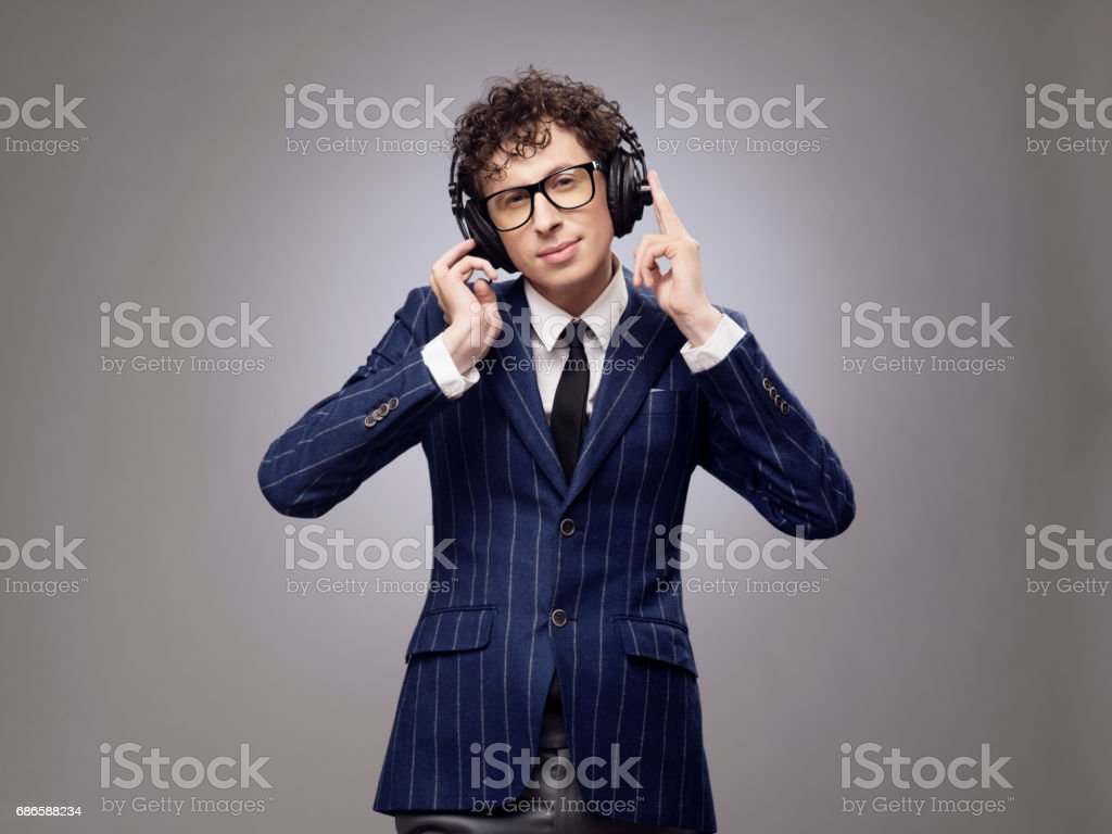 Funny man in headphones listening music stock photo