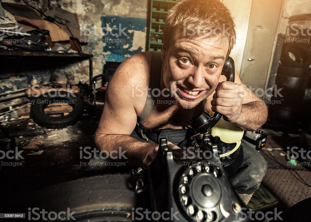 Funny man on the phone stock photo