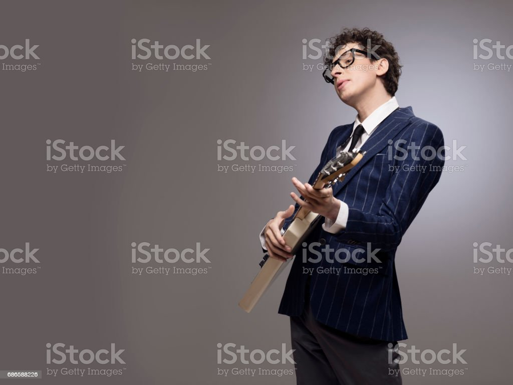 Funny man playing electric guitar stock photo