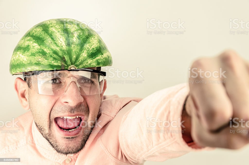 Funny man with a watermelon on his head. stock photo