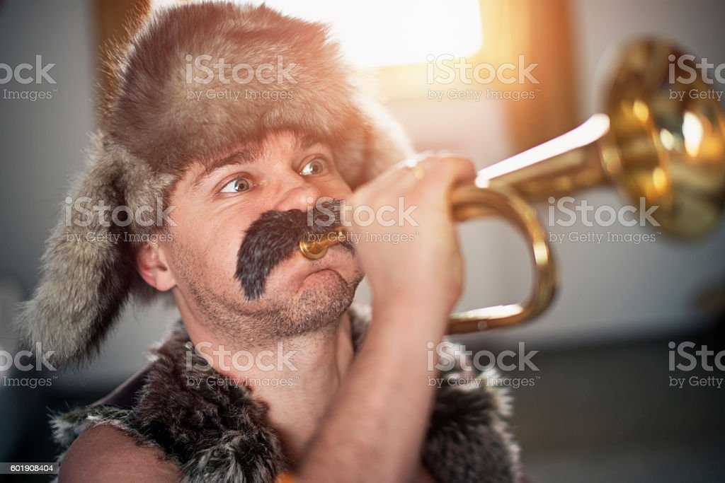 Funny man with big moustache playing trumpet stock photo