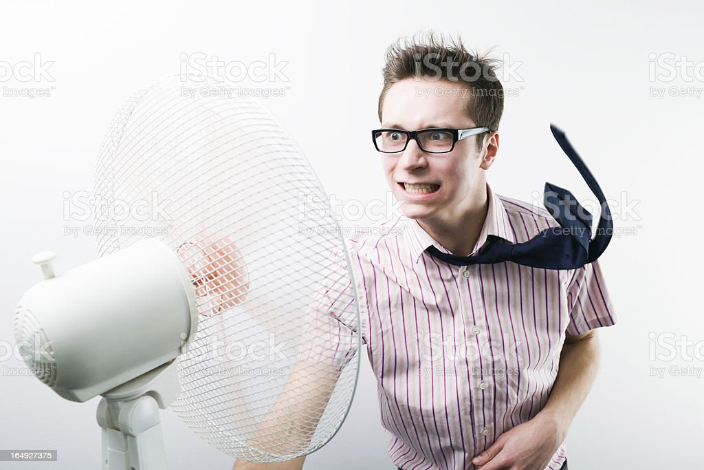 Funny man with fan stock photo