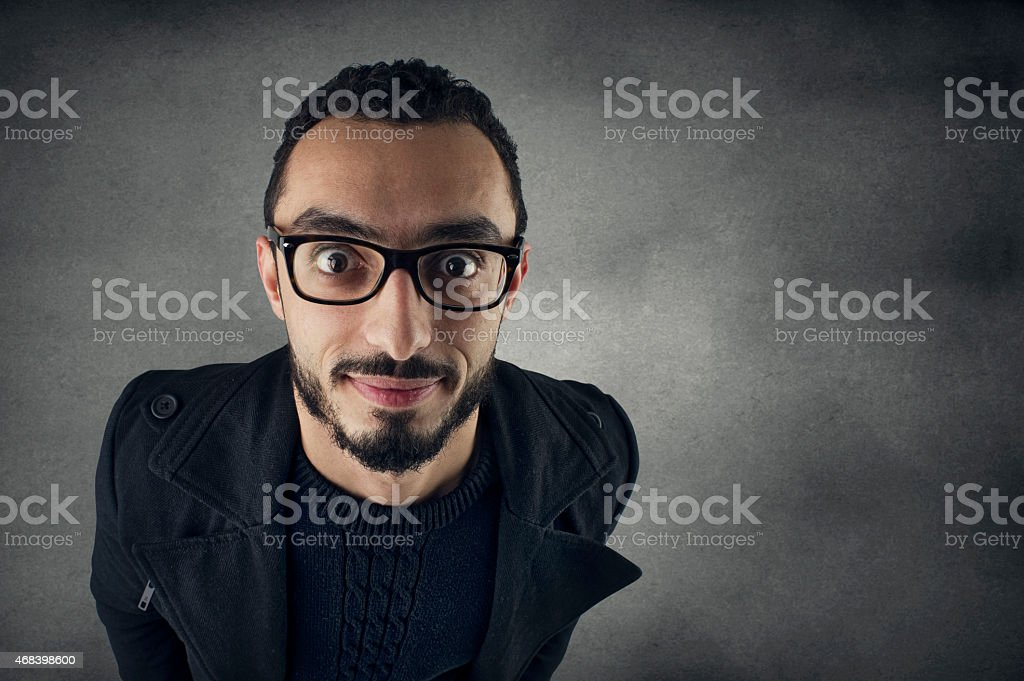funny man with Nerd glasses smiling - wide angle shot stock photo