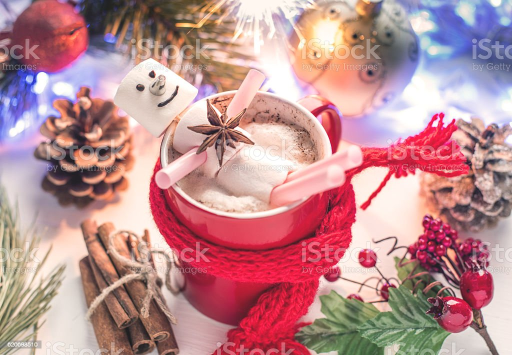 Funny marshmallow snowman in red cup of hot chocolate stock photo