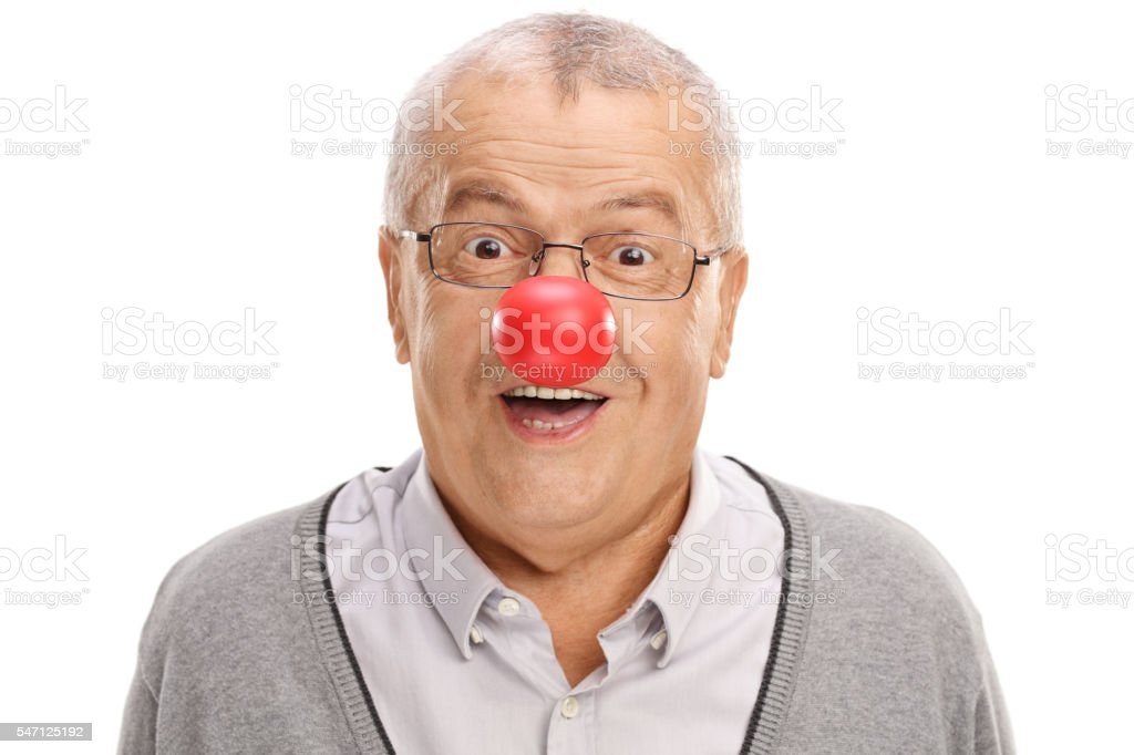 Funny mature man with a clown nose stock photo