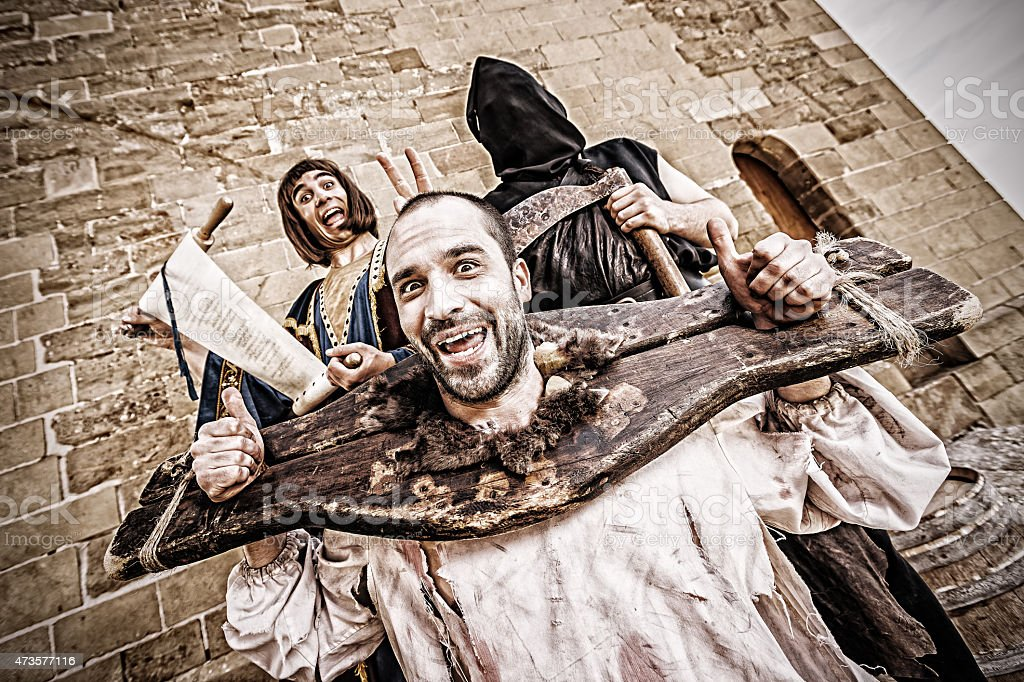 Funny medieval public beheading stock photo