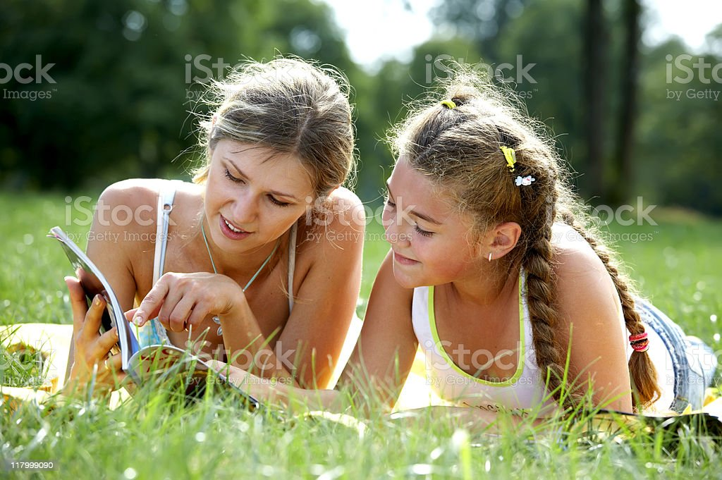 Funny mom and daughter reading royalty-free stock photo