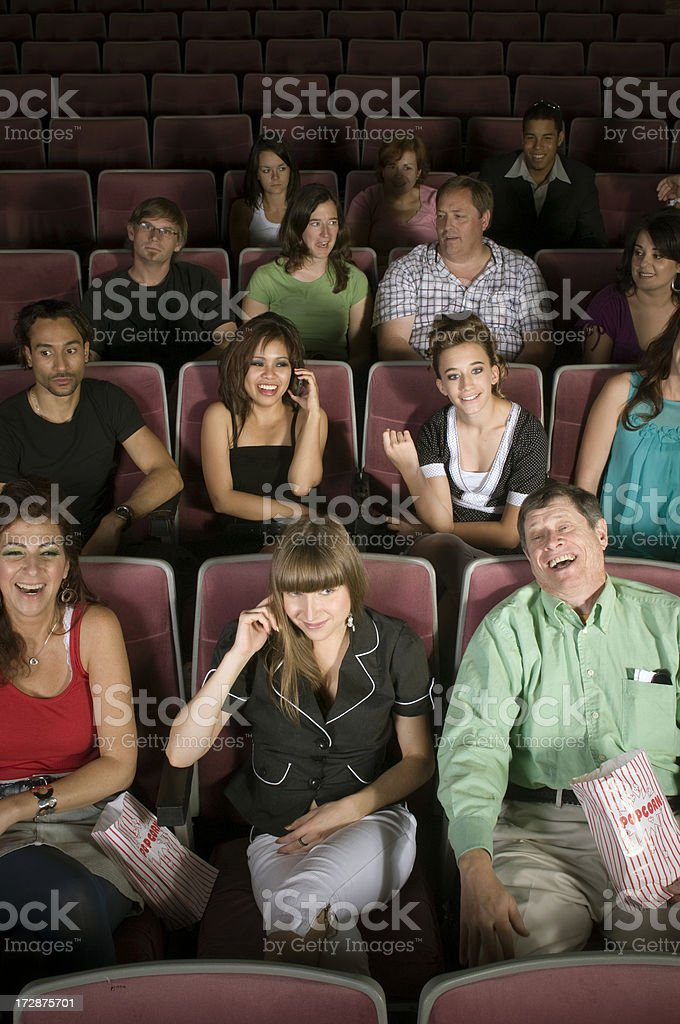 Funny Movie and Cell Phone Ettiquette royalty-free stock photo