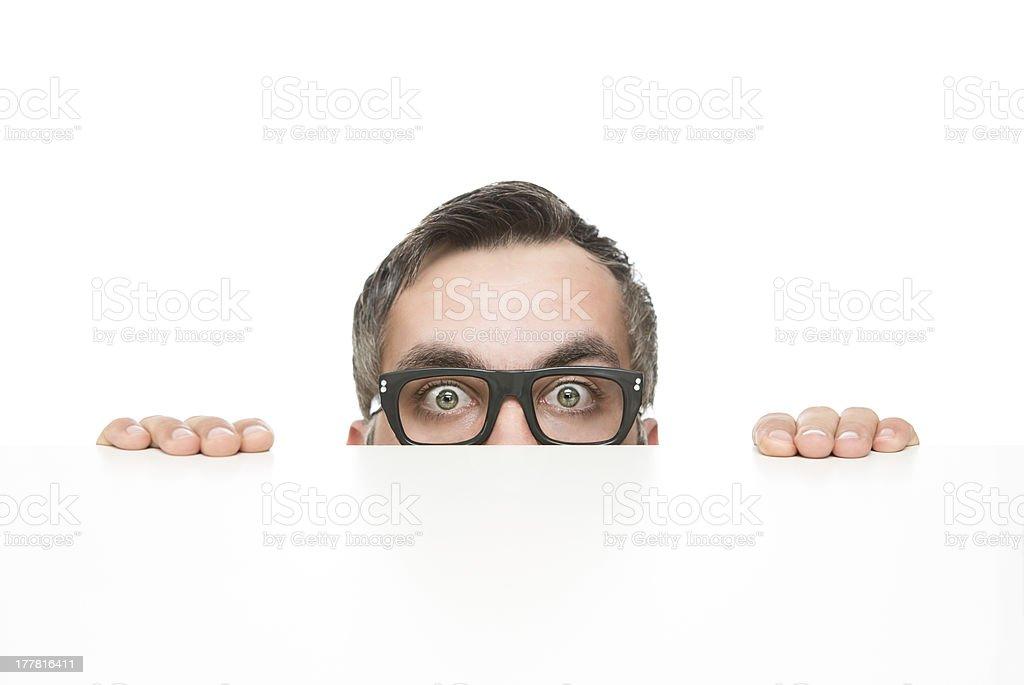 Funny nerd peeking stock photo