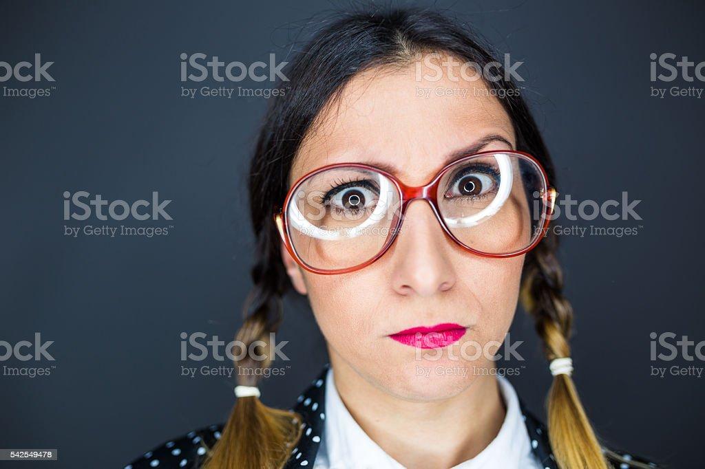 Funny nerd woman grimacing stock photo