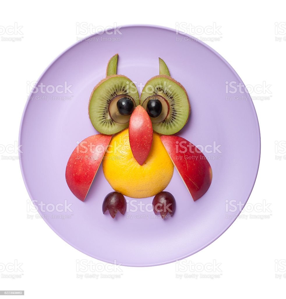 Funny owl made of fruits stock photo