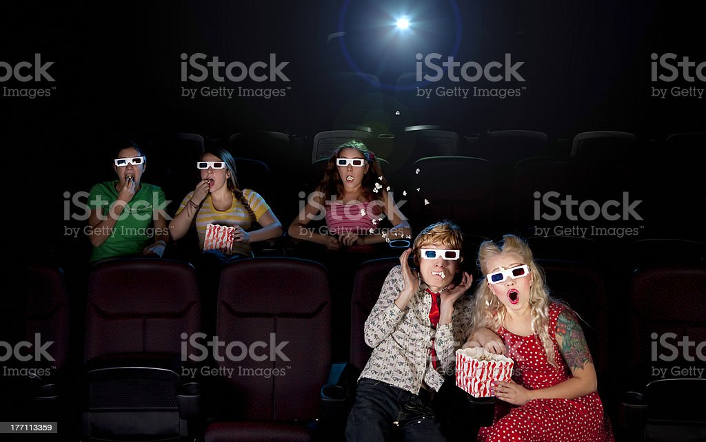 Funny people are watching scary 3d movie royalty-free stock photo