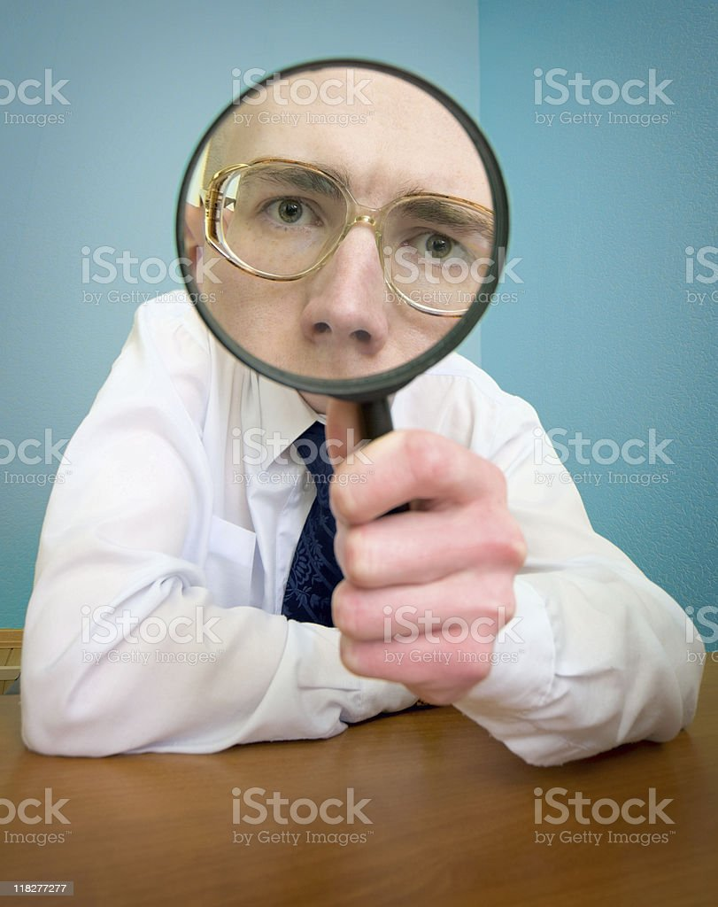 Funny people with a magnifier royalty-free stock photo