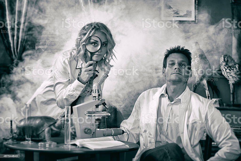 Funny photograph of scientists in laboratory with smoke stock photo