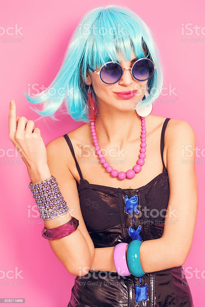 Funny pop girl portrait wearing weird accessories stock photo
