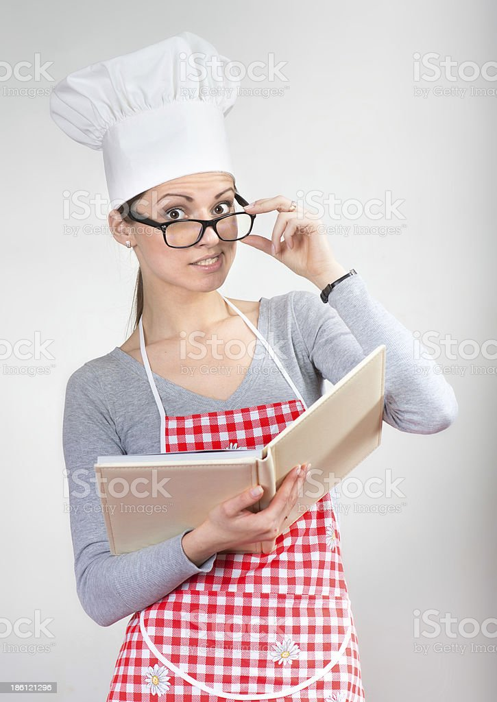 Funny portrait of a woman in chef's hat stock photo