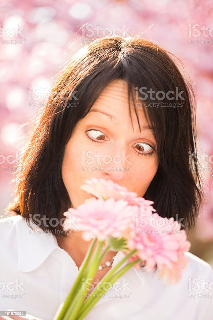 Funny portrait of mature woman with flowers royalty-free stock photo
