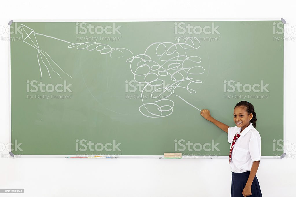 funny primary schoolgirl flying an impossible kite royalty-free stock photo