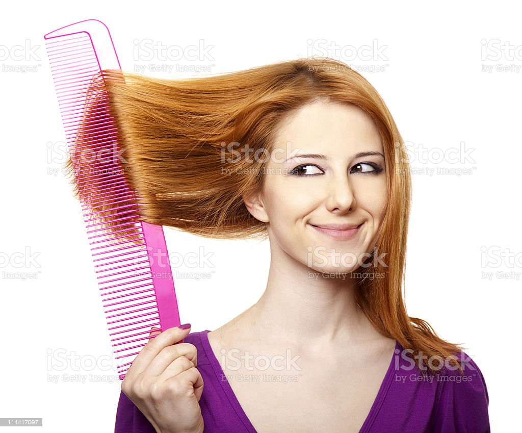 Funny red-haired girl with big comb. royalty-free stock photo