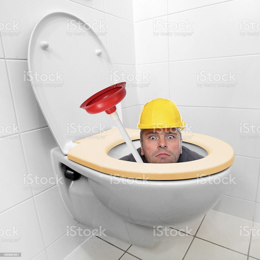 Funny repairman. stock photo