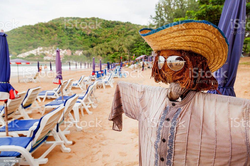 Funny scarecrow on beach. Stylish bogeyman on Phuket island, Thailand. stock photo