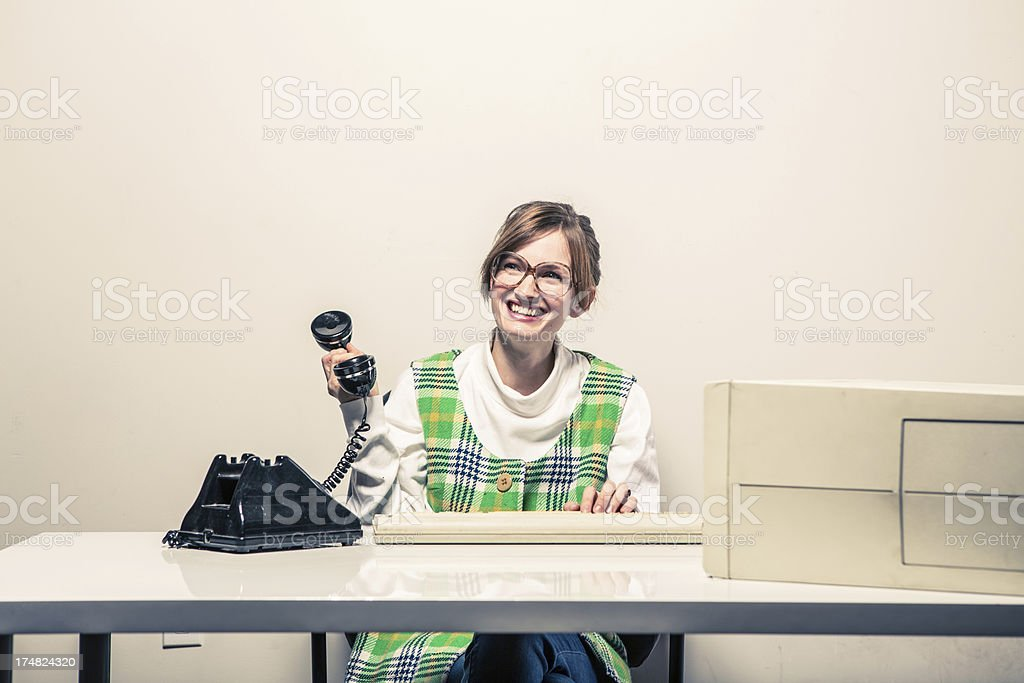 Funny Secretary at Her Desk with Phone and Computer royalty-free stock photo