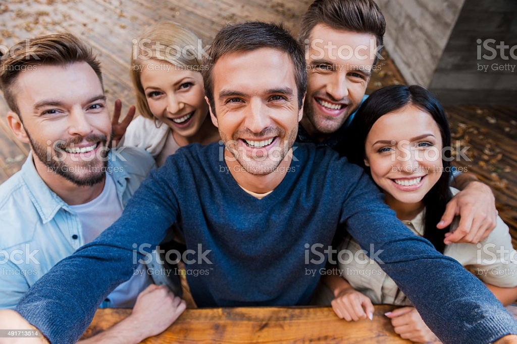 Funny selfie with friends. stock photo