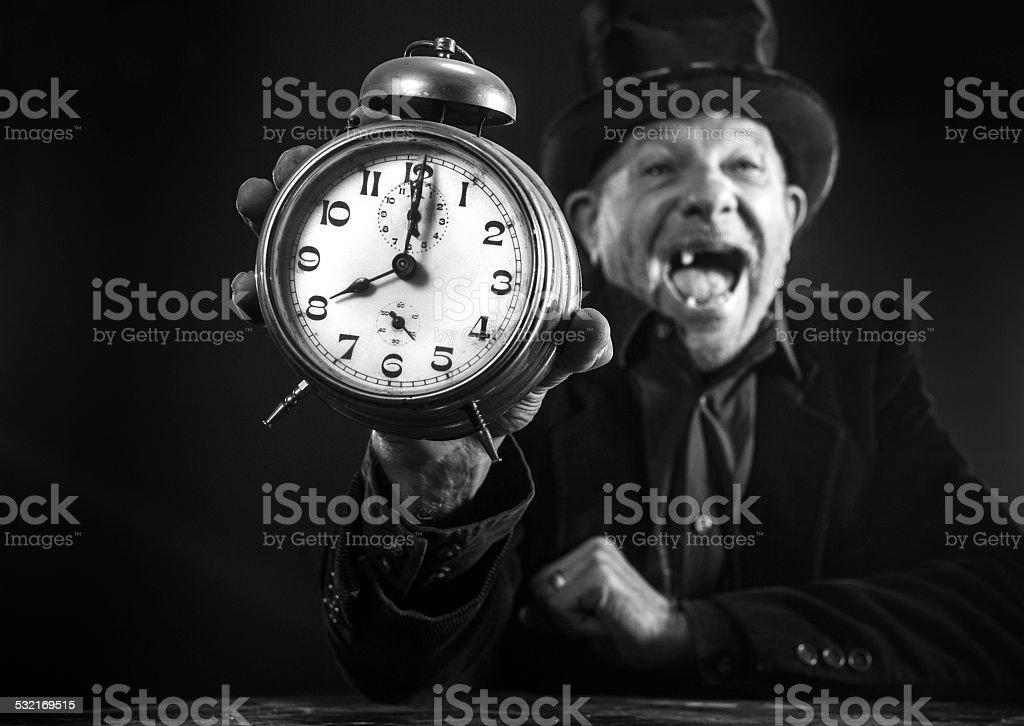Funny senior man with alarm clock stock photo