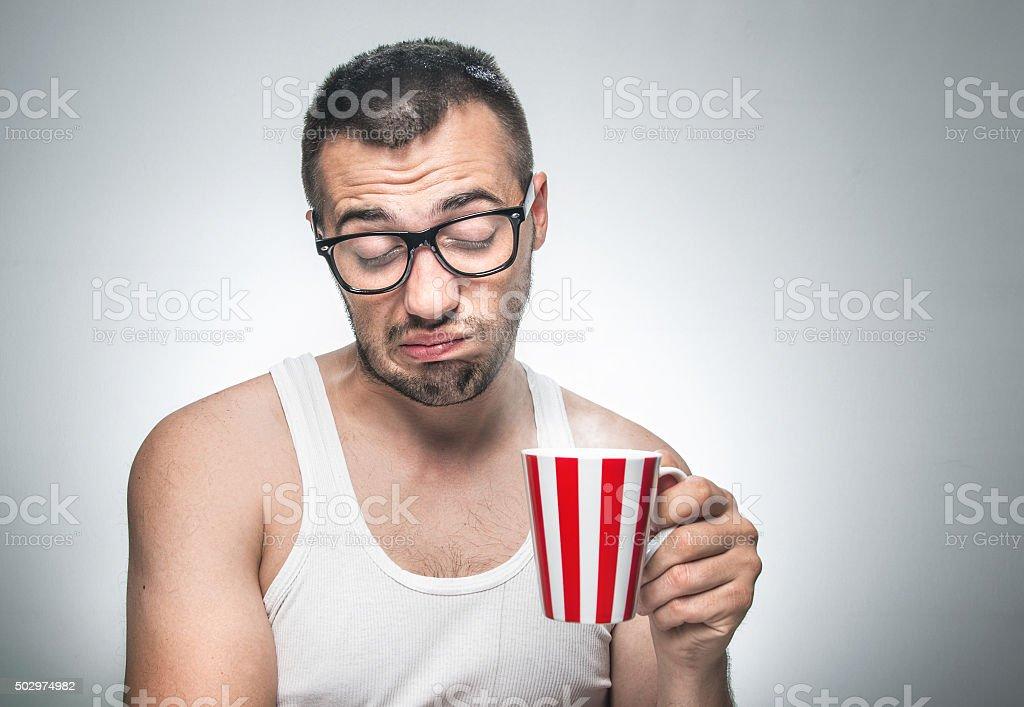 Funny sleepy man with cup coffee stock photo