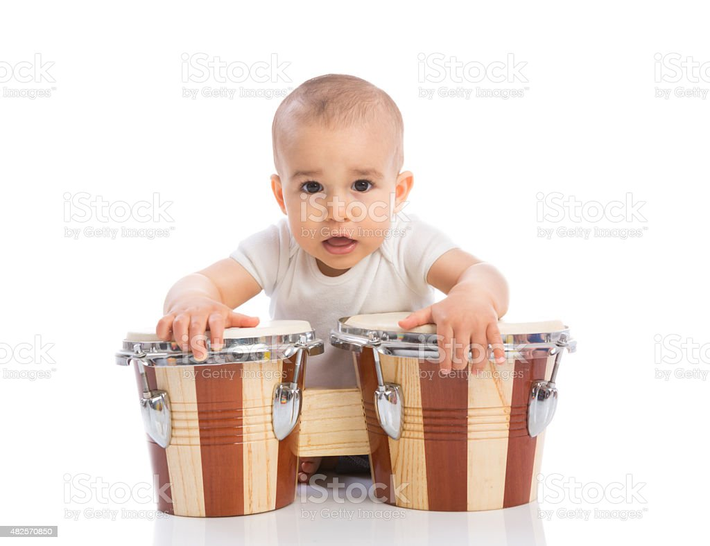 Funny smiling baby with bongos stock photo