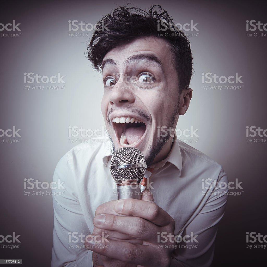 funny stylish businessman singing royalty-free stock photo