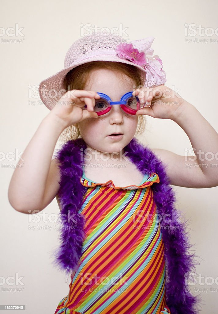 Funny swimsuit girl with goggles stock photo