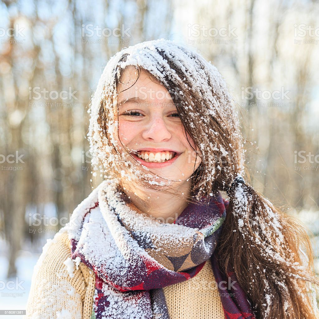 funny teenager girl portrait with the snow on the hair stock photo