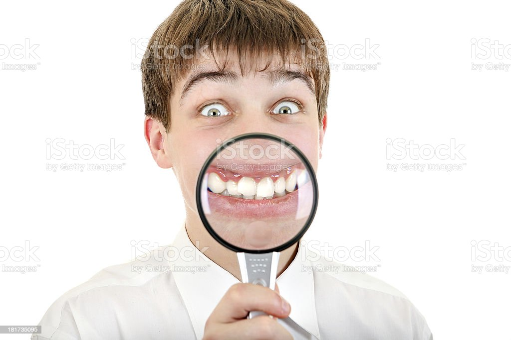 Funny Teenager with a Loupe stock photo