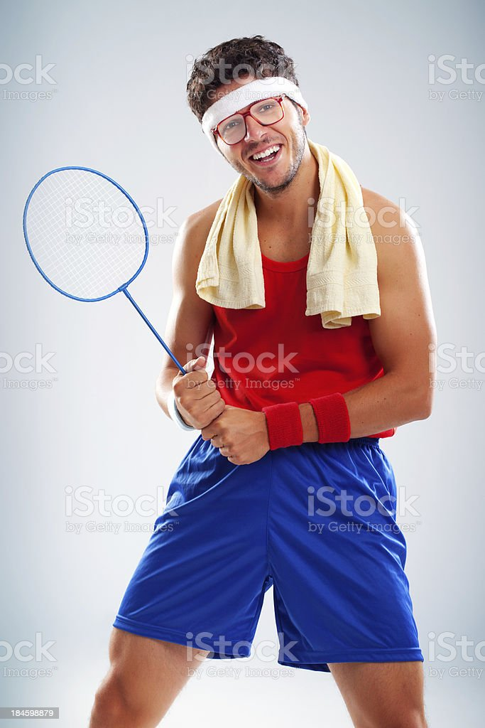 Funny tennis player posing with his small blue badminton racket royalty-free stock photo