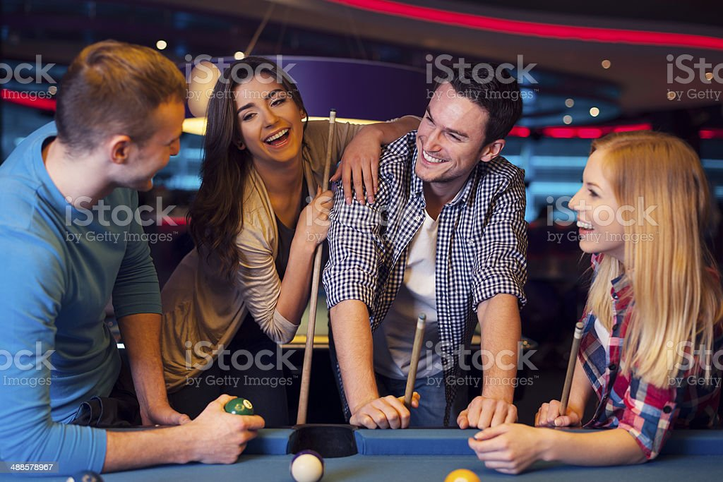 Funny time with friends in billiard club stock photo