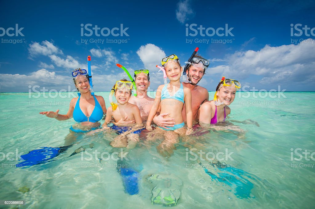 funny tourists in tropical sea stock photo