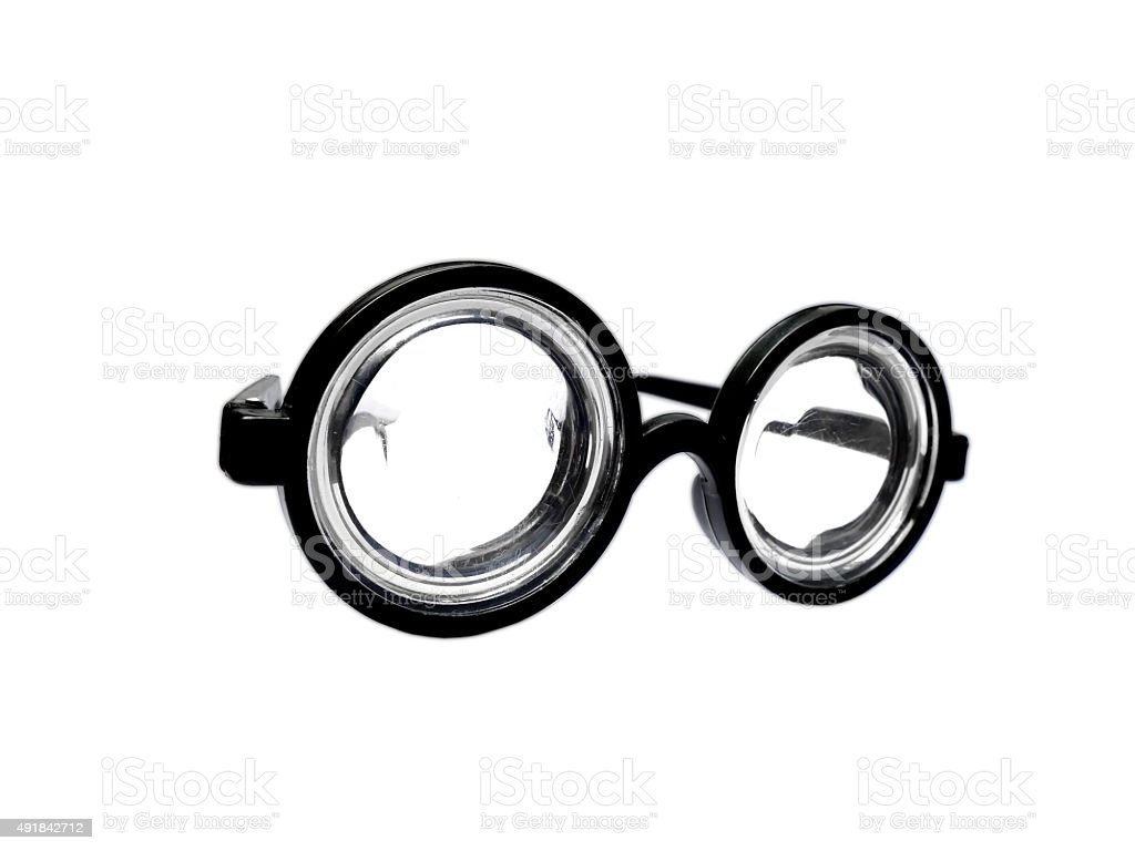 Funny toy short-sighted glasses with heavy scratching isolated stock photo