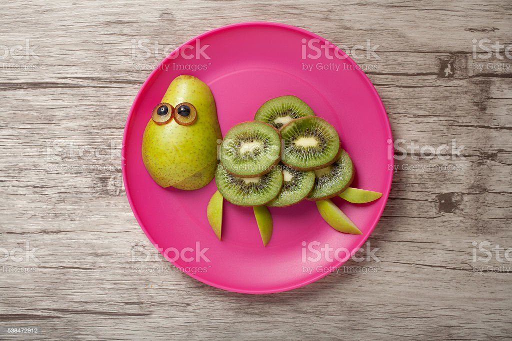 Funny turtle made of fruits stock photo