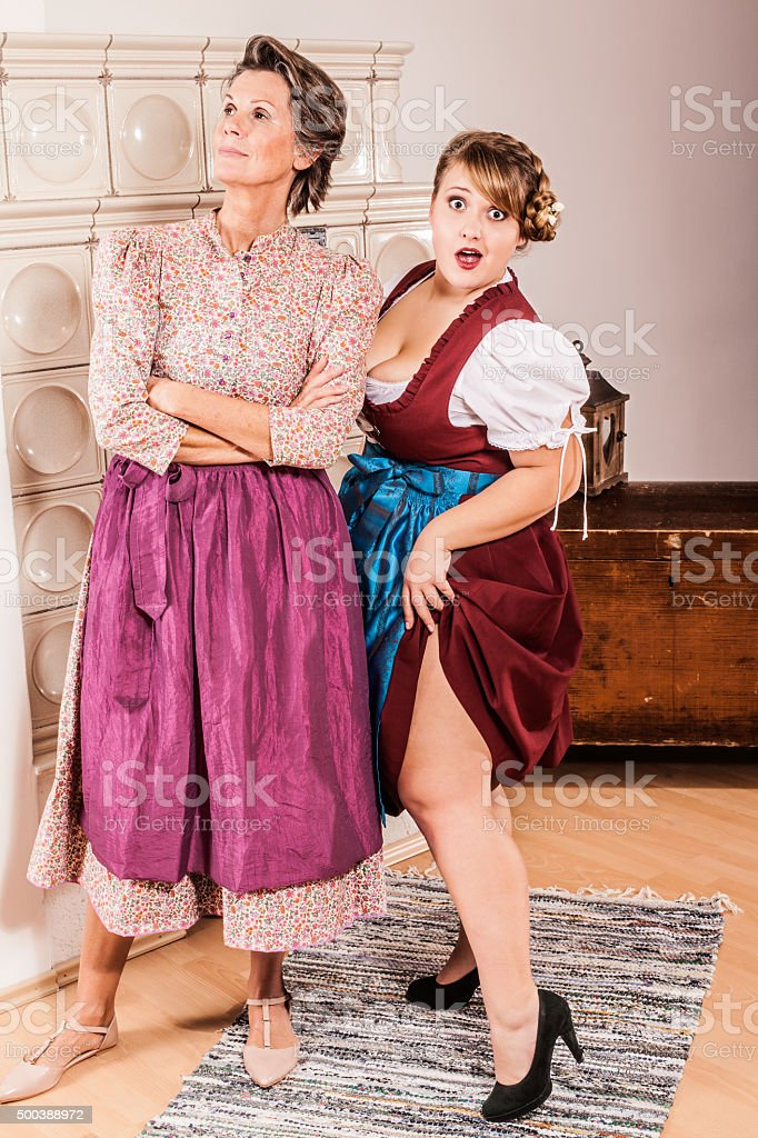 Funny two generations of two women in dirndl stock photo