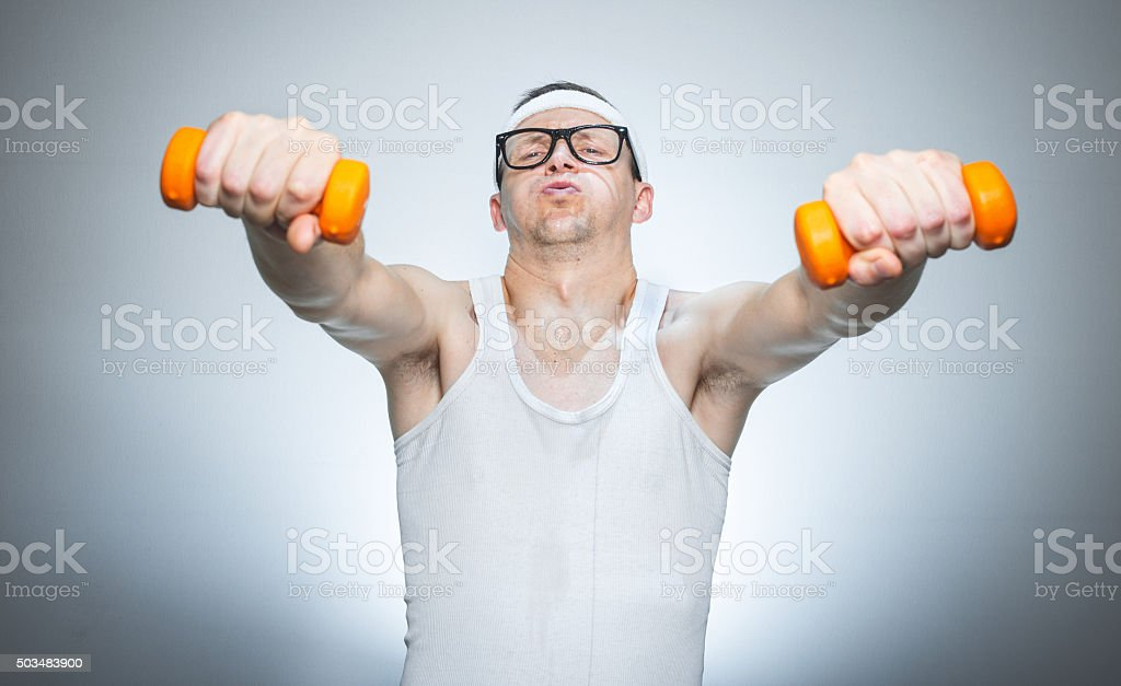 Funny weak man lifting shoulders stock photo