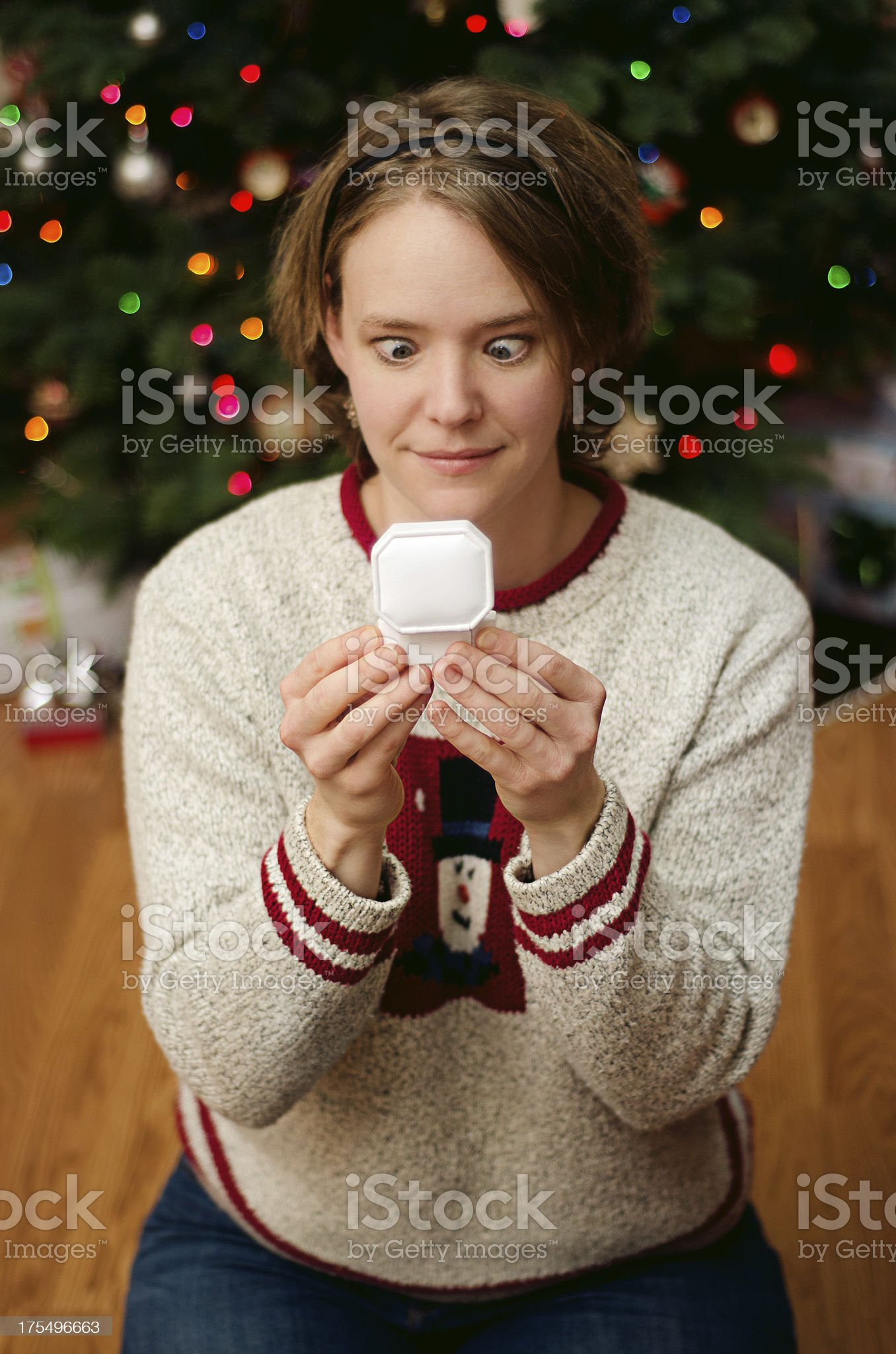 Funny woman receiving a ring for Christmas royalty-free stock photo