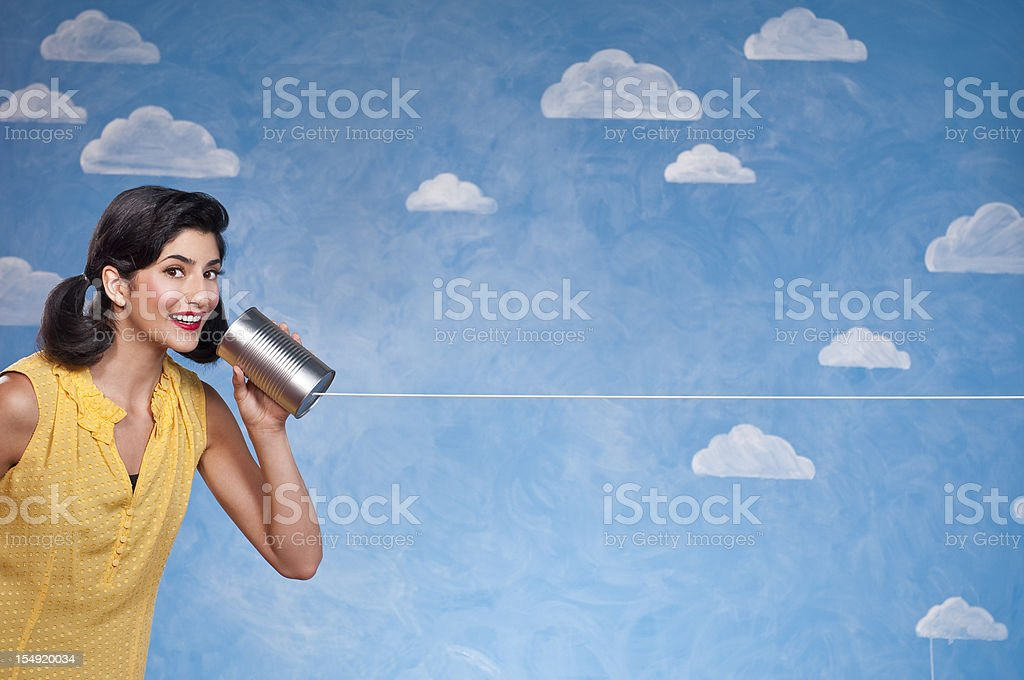 Funny Woman With Tin Can Telephone stock photo