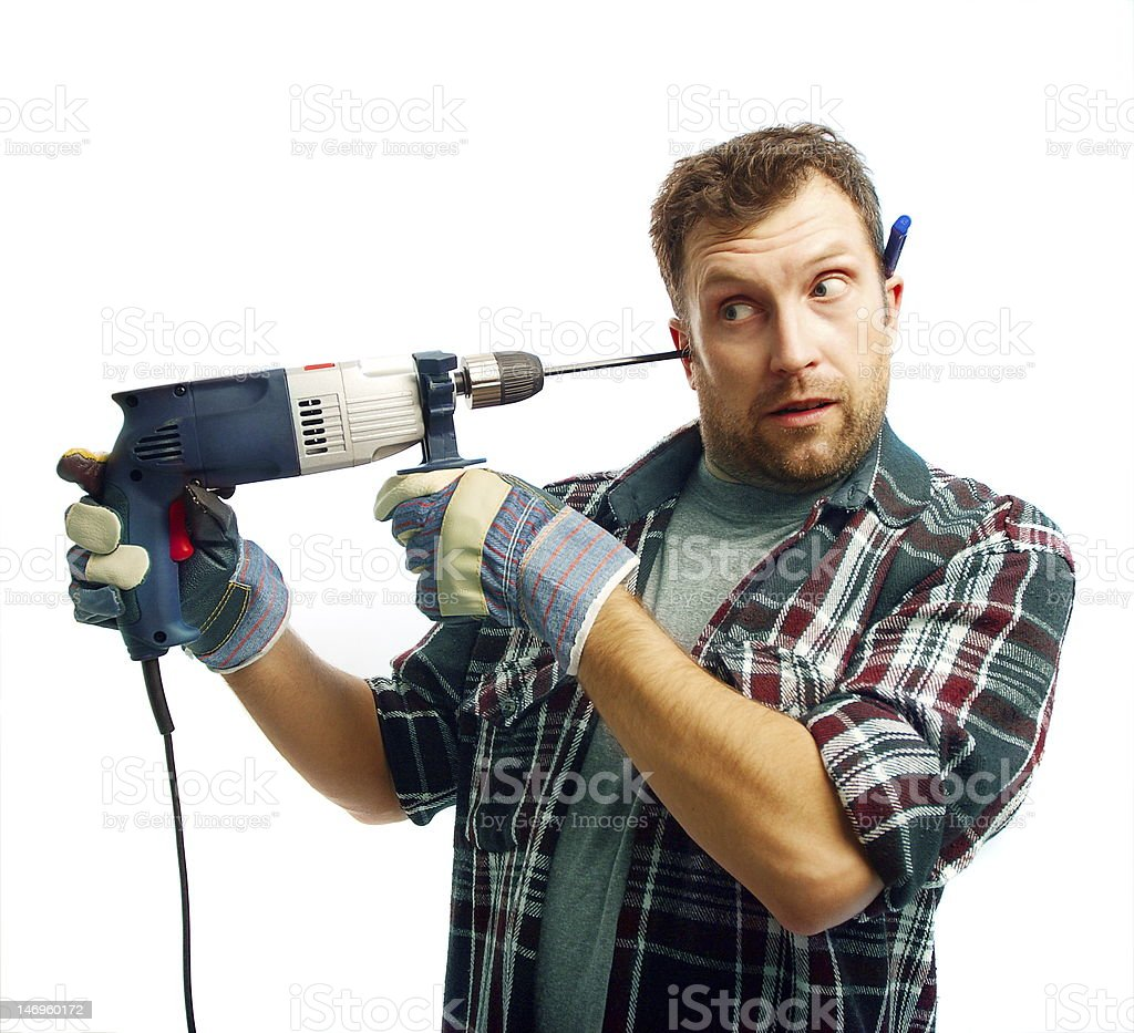 Funny workman with drill boring his ear stock photo