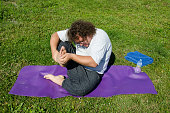 Funny yoga and fat guy on the nature.